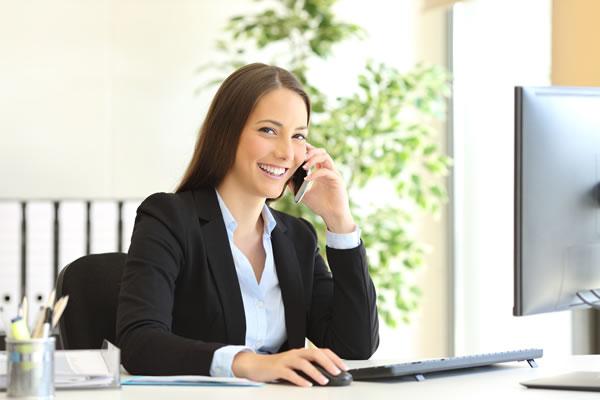 Corporate secretary talking on phone